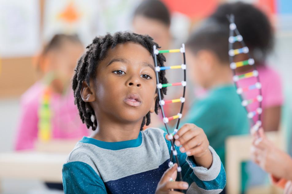 boy studying DNA strand science STEM toys